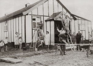 Villagers cleaning the old village hall, mid 1960s. Newspaper clipping.